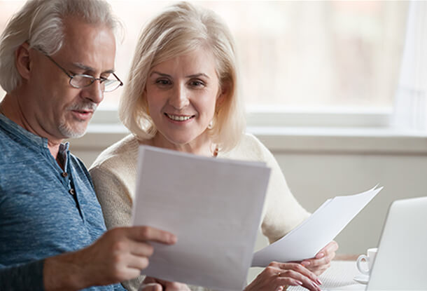 Older couple discussing financial documents
